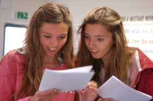 Bryony, and sister Sophie celebrate their A-Level results at Wollaston School in 2015.